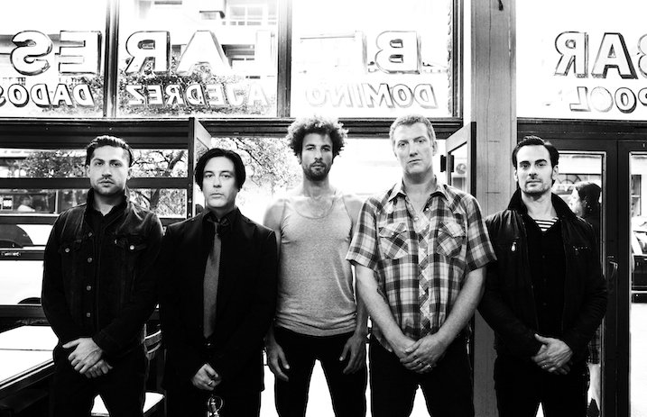 QOTSA Frontman Kicks Photographer In The Face During Performance
